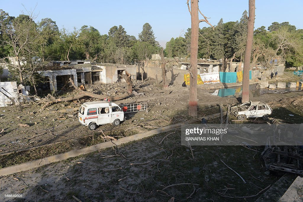 A general view of the destruction is seen of an overnight suicide bombing in Quetta on May 13, 2013. The police chief of Pakistan's restive southwestern province of Baluchistan narrowly escaped a suicide attack on May 12 that killed at least six people and wounded 46 others, officials said.