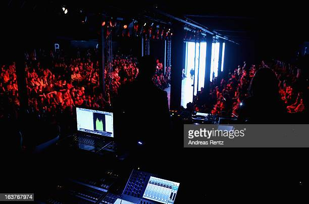 A general view of the DJ booth as a model walks the runway at the Hakan Akkaya show during MercedesBenz Fashion Week Istanbul Fall/Winter 2013/14 at...