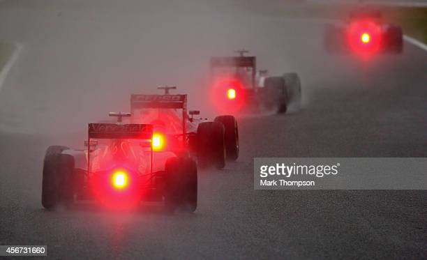 A general view of the drivers Adrian Sutil of Germany and Sauber F1 they battle against atrocious conditions during the Japanese Formula One Grand...