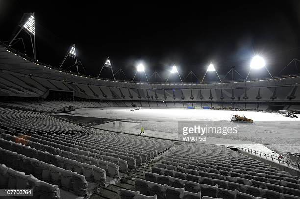 A general view of the empty snowcovered London 2012 Olympic Stadium after an official switching on ceremony of the floodlights on December 20 2010 in...