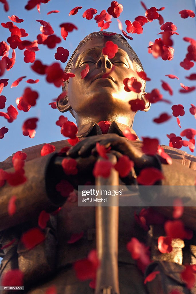 A general view of the Every Man Remembered statue in George Square on November 7, 2016 in Glasgow, Scotland. The 23ft WW1 travelling statue Every Man Remembered, designed by Mark Humphrey, is in Glasgow as part of this year's Scottish Poppy Appeal. It depicts a figure in brass of the Unknown Soldier standing on a block of limestone from the Somme in France, with hundreds of poppies floating around its glass case.
