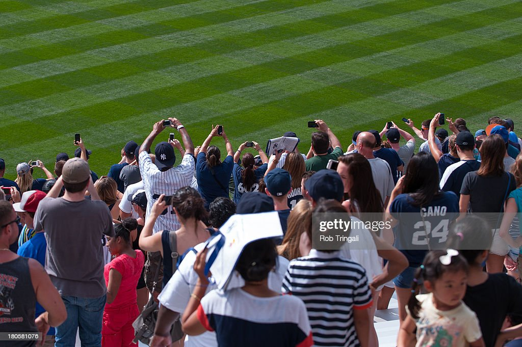 A general view of the fans cheering as Mariano Rivera #42 of the New York Yankees enters the game against the Detroit Tigers at Yankee Stadium on August 11, 2013 in the Bronx borough of Manhattan.