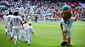 General view of the fans of FC Copenhagen mascot Leo the Lion and the players of FC Copenhagen walking on to the pitch prior to the Danish Alka...