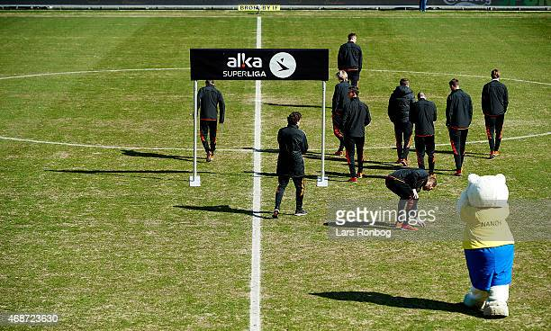 General view of the FC Copenhagen players walking on the bad pitch prior to the Danish Alka Superliga match between Brondby IF and FC Copenhagen at...