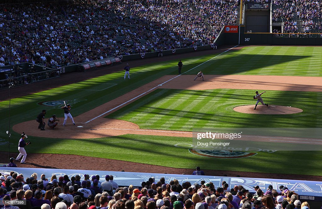 General view of the field as starting pitcher Barry Zito #75 of the San Francisco Giants delivers against the Colorado Rockies on Opening Day at Coors Field on April 9, 2012 in Denver, Colorado. Zito pitched a complete game and earned the win as the Giants defeated the Rockies 7-0.