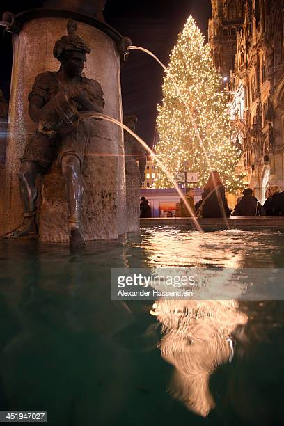 General view of the Fish fontain at Marienplatz and the Town Hall on its opening day of the annual Christmas market on November 25 0213 in Munich...
