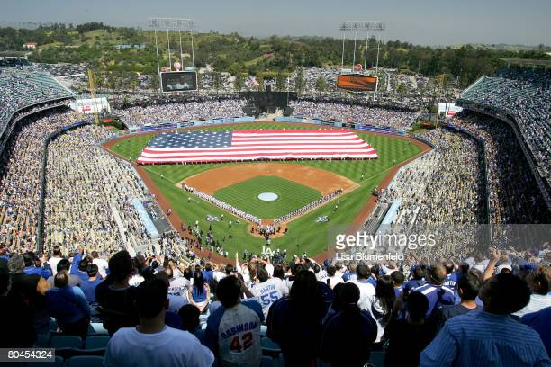 A general view of the flag on the field before the Los Angeles Dodgers Opening Day game against the San Francisco Giants at Dodger Stadium on March...