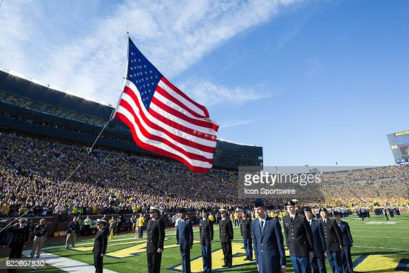 A general view of the flag raising ceremony prior to the start of the game between the Maryland Terrapins and the Michigan Wolverines on November 5...