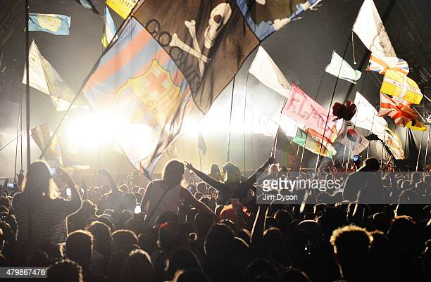 A general view of the flags and crowd in front of the Pyramid stage as Kanye West performs live during the second day of Glastonbury Festival at...