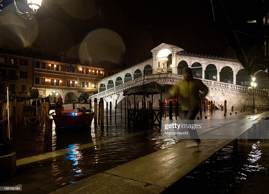 A general view of the flooded Rialto area just after midnight, when the water level was around 140cm on November 1, 2012 in Venice, Italy. More than 59% of Venice has been been left flooded, after the historic town was hit by exceptionally high tides. The sea level rose above 140cm overnight was expected to remain above critical levels for about 15 hours.