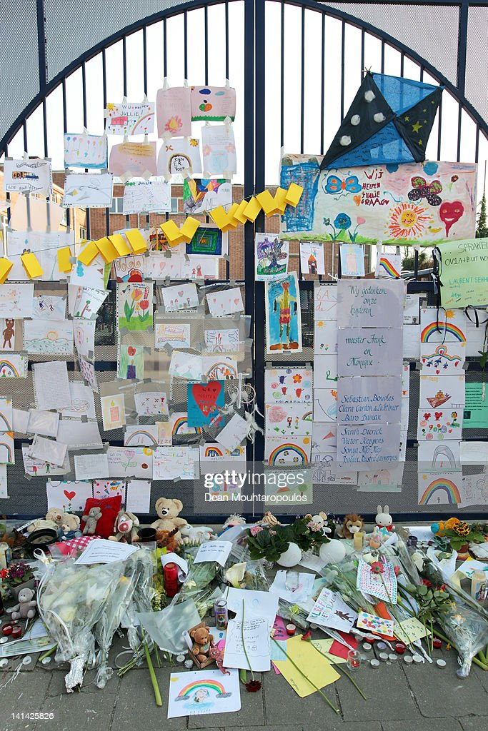 A general view of the front at of Saint Lambertus School that has been covered with flowers, toys, candles and messages of love and support during a national day of mourning on March 16, 2012 in Heverlee, Belgium. Belgium held a national day of mourning to remember all the who died in a coach crash earlier this week. The accident occurred when a school bus carrying 11 -12 year olds, returning from a skiing holiday, crashed into a tunnel wall, killing 28 of the 52 passengers.