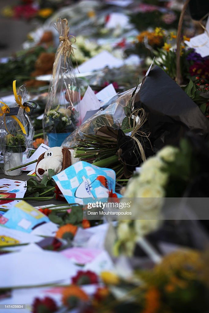 A general view of the front wall of Saint Lambertus School that has been covered with flowers, toys, candles and messages of love and support during a national day of mourning on March 16, 2012 in Heverlee, Belgium. Belgium held a national day of mourning to remember all the who died in a coach crash earlier this week. The accident occurred when a school bus carrying 11 -12 year olds, returning from a skiing holiday, crashed into a tunnel wall, killing 28 of the 52 passengers.