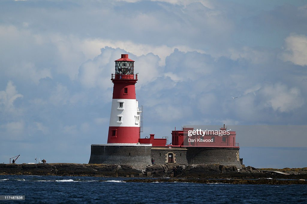 A general view of the fully automated Longstone Lighthouse which was built in 1825 on June 25, 2011 at the Farne Islands, England. In 1838 Grace Darling and her father set out to rescue the survivors of a wrecked paddle-steamer, the Forfarshire, when it ran aground on a nearby islet. The Farne Islands, which are run by the National Trust, are situated two to three miles off the Northumberland coastline. The archipeligo of 16-28 separate islands (depending on the tide) make the summer home to approximately 100,000 pairs of breeding seabirds including around 36,000 Puffins, 32,000 Guillemots and 2,000 pairs of Arctic Terns. The species of birds which nest in internationally important numbers include Shag, Sandwich Tern and Arctic Tern. The coastline around The Farnes are also the breeding ground to one of Europe's largest Grey Seal colonies with around 4,000 adults giving birth to 1500 pups every year.