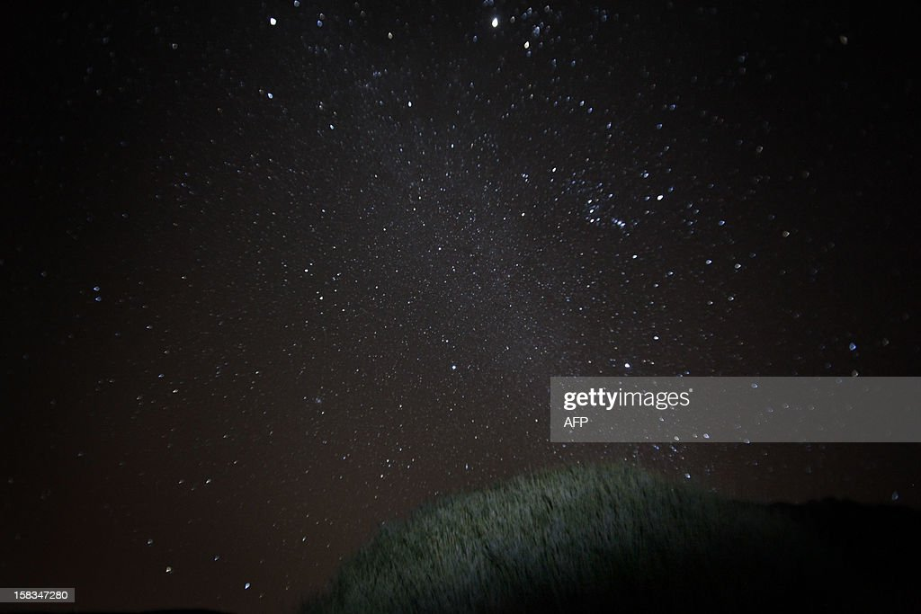 A general view of the Geminid meteor shower in the National Park of El Teide on the Spanish canary island of Tenerife on December 13, 2012. AFP PHOTO / DESIREE MARTIN