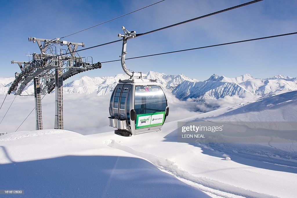 A general view of the gondola cable-car system at the peak of Mount Aigba in the Rosa Khutor Extreme Park, some 50 km from Russia's Black Sea resort of Sochi, on February 13, 2013. With a year to go until the Sochi 2014 Winter Games, construction work continues as tests events and World Championship competitions are underway.