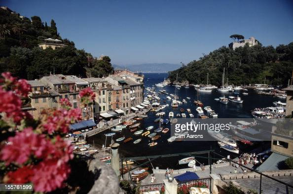 General view of the harbour area crowded with small and large boats in Portofino Italy 1977