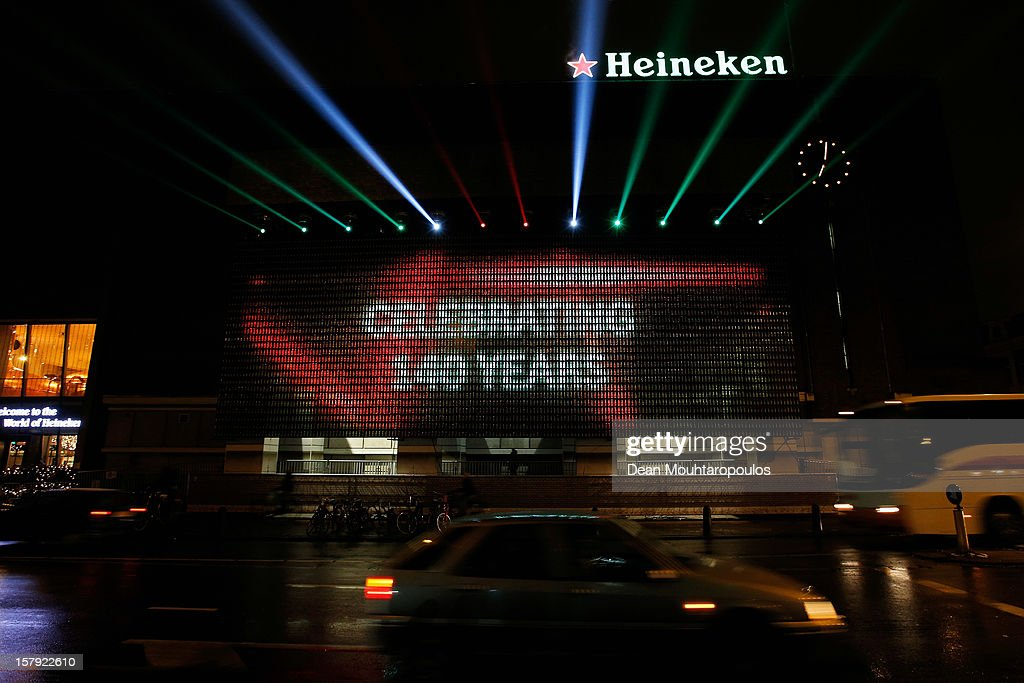 A general view of the Heineken Light Installation at Heineken Experience on December 7, 2012 in Amsterdam, Netherlands. Heineken marks its 140-year anniversary by inviting people to be part of the celebration in a major light installation on the wall of its spiritual home, brought to life through social media. Created from 5,000 iconic Heineken bottles the LED-lit exhibit will stand tall outside the Heineken Experience in the centre of Amsterdam, December 7th 2012- January 3rd 2013 as one of the Amsterdam Light Festival's highlights. As part of an open global party people are invited to share their own celebration messages through Facebook which will light up in a dynamic animated showcase, alongside bold images inspired by the brand's iconic history.