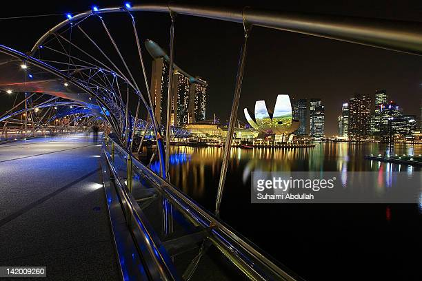 A general view of the Helix Bridge Marina Bay Sands ArtScience Museum and the central business district skyline on March 28 2012 in Singapore...