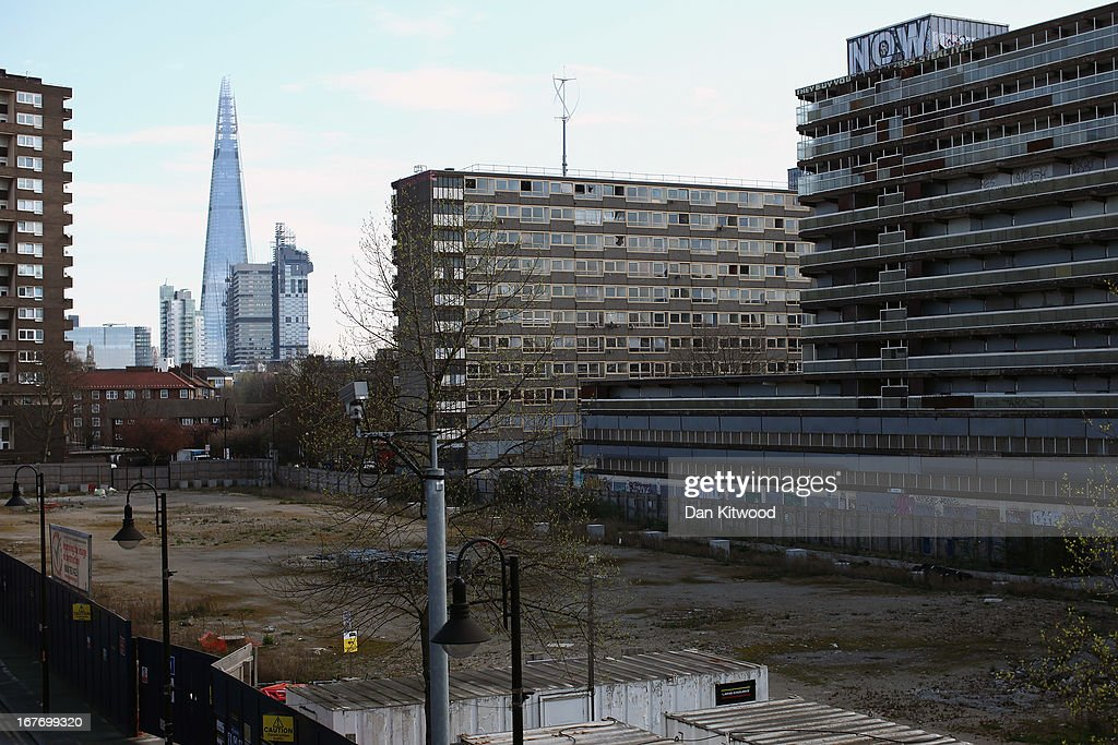 A general view of the Heygate Estate with The Shard in the background in the Walworth area on April 24, 2013 in London, England. The Heygate estate in central London was built in 1974 as social housing and housed around 3000 people, but fell into a state of disrepair, gaining a reputation for crime and poverty. The estate is due to be demolished as part of the £1.5billion GBP 'Elephant & Castle regeneration scheme', and replaced with 2,500 'affordable' new homes. The area has become popular with street artists, storytellers, and guerilla gardeners and attracts an array of urban wildlife including bats, birds and mammals.