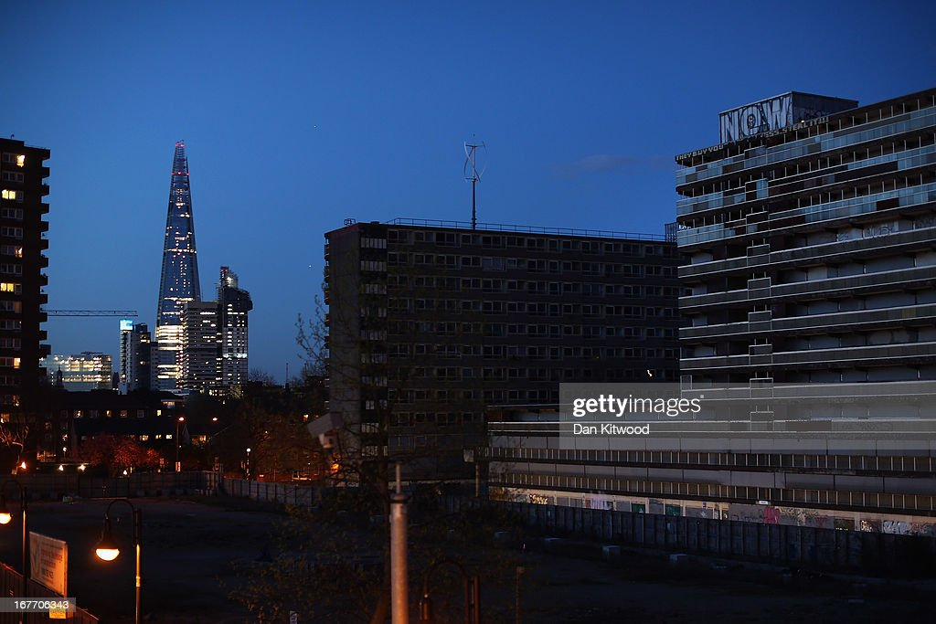 A general view of the Heygate Estate (to the right) with The Shard in the background in the Walworth area at twilight on April 26, 2013 in London, England. The Heygate estate in central London was built in 1974 as social housing and housed around 3000 people, but fell into a state of disrepair, gaining a reputation for crime and poverty. The estate is due to be demolished as part of the £1.5billion GBP 'Elephant & Castle regeneration scheme', and replaced with 2,500 'affordable' new homes. The area has become popular with street artists, storytellers, and guerilla gardeners and attracts an array of urban wildlife including bats, birds and mammals.