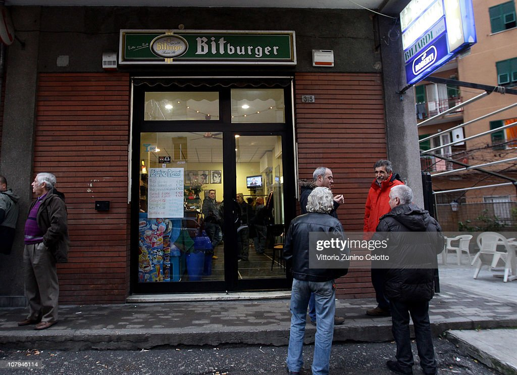 A general view of the 'Il gatto e la volpe' bar where Carlo Trabona killed two of his neighbours on January 9, 2011 in Genoa, Italy. Carlo Trabona, a 74-year-old retired bricklayer, has shot dead two of his neighbours and then killed his wife, before shooting himself after being surrounded by the Police in Genoa. Police suspect Jealousy, over alleged infidelity by Trabona's wife, was the motive for the murders.
