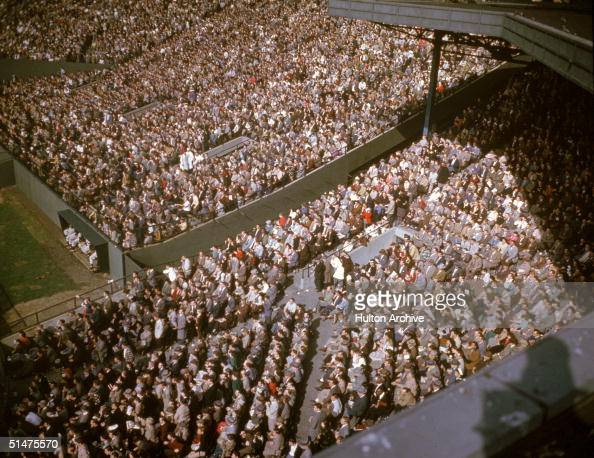 General view of the infield and leftfield bleachers crowded with fans at Boston's Fenway Park home of the American League baseball team the Boston...