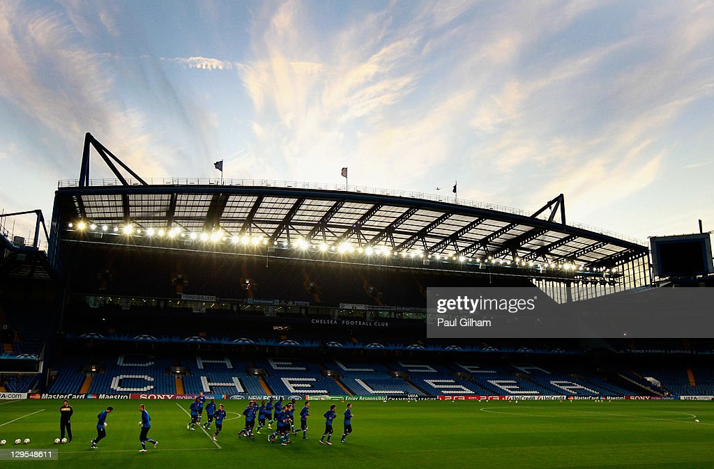 A general view of the KRC Genk players warming up during a KRC Genk training session ahead of the UEFA Champions League Group E match against Chelsea...