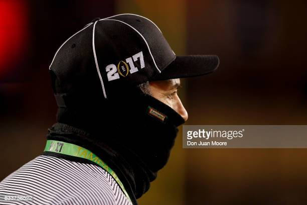 A general view of the line officials with his face covered up and a CFP 2017 logo cap during the 2017 College Football Playoff National Championship...