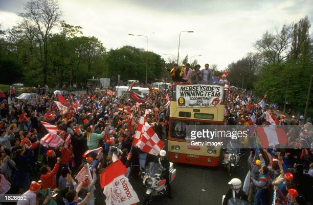 General view of the Liverpool team bus surrounded by supporters during their homecoming after their victory in the the FA Cup final against Everton...
