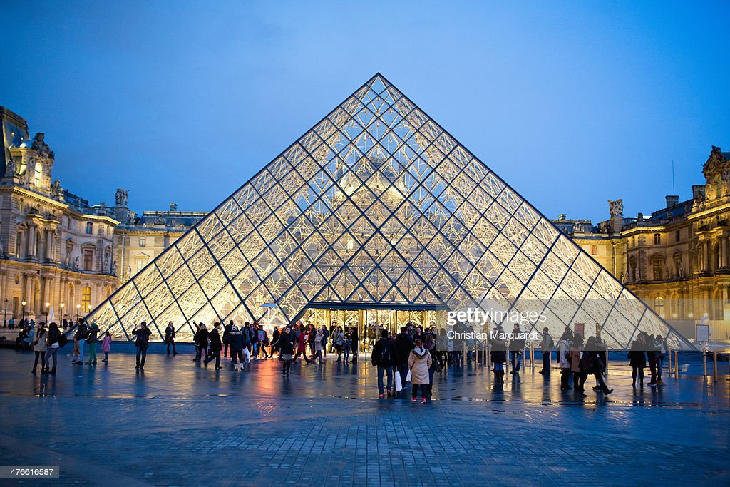 A general view of the Louvre museum with the entrance pyramide is pictured in the evening on February 28, 2014 in Paris, France. The museum is housed in the Louvre Palace, one of the world's largest museums which opened 1793.