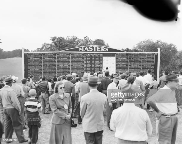 A general view of the main leaderboard and patrons during the 1949 Masters Tournament at Augusta National Golf Club in April 1949 in Augusta Georgia