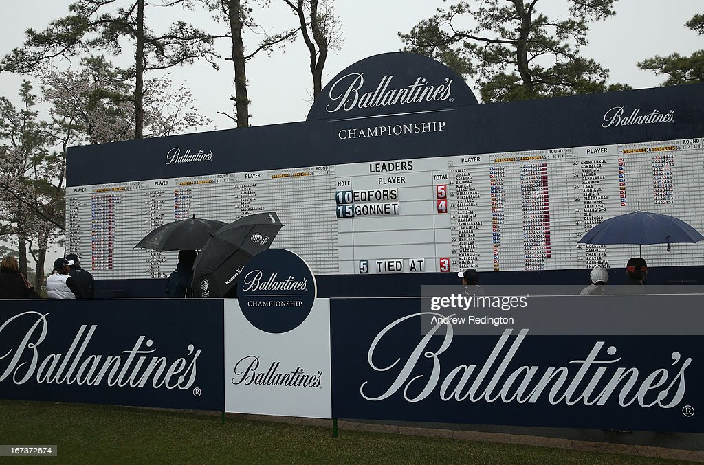 A general view of the main scoreboard as poor visibility and rain cause a weather delay during the first round of the Ballantine's Championship at Blackstone Golf Club on April 25, 2013 in Icheon, South Korea.