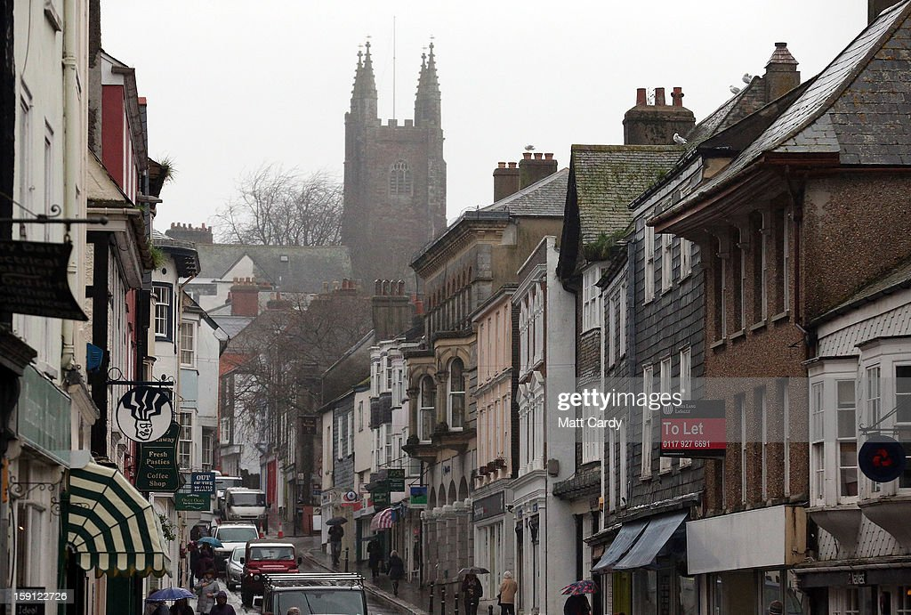 A general view of the main shopping street of Totnes is seen on January 8, 2013 in Totnes, England. The Devon town is renowned for its belief in promoting trade of local independent retailers, famously denying the plans by national coffee chain Costa to open a high street branch in the town. Boasting its own local currency, Totnes has a shop vacancy rate of 6%, less than half than the national average, whilst 80% of outlets are independently owned.