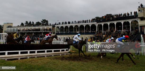 A general view of the Main Stand at Ludlow race course with the runners and riders of the Sidney Phillips Novices' Handicap Chase at Ludlow...