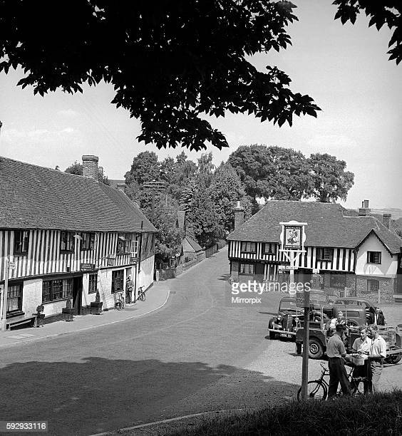 General view of the main street running though the village of Ightham near Sevenoaks in Kent showing local shops and the pub May 1952