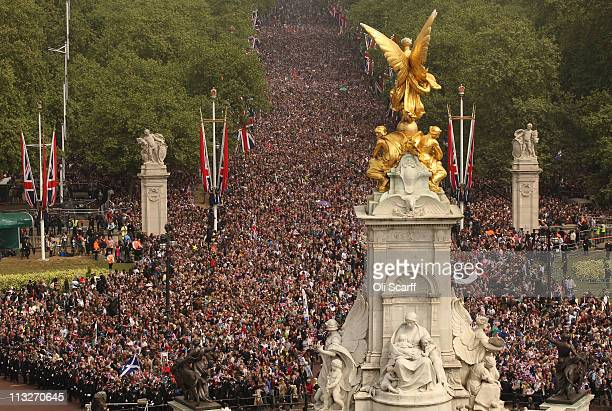 A general view of the Mall and Victoria Memorial filled with wellwishers celebrating the Royal Wedding of Prince William Duke of Cambridge and...