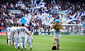 General view of the mascot Leo the Lion and the players of FC Copenhagen walking on to the pitch prior to the Danish Alka Superliga match between FC...