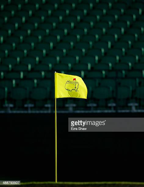 A general view of the Masters flag and empty grandstands prior to the start of the 2014 Masters Tournament at Augusta National Golf Club on April 9...