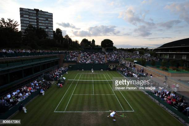 General view of the match between Aliaksandra Sasnovich and Jelena Ostapenko on court Eighteen on day one of the Wimbledon Championships at The All...