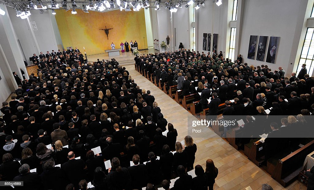General view of the memorial service at the Sankt Karl Barromaeus church on March 21, 2009 in Winnenden near Stuttgart, Germany. President Koehler, chancellor Merkel and thousands of mourners hold a memorial ceremony to commemorate the victims of a school shooting. 17 - year old Tim Kretschmer opened fire on Wednesday, March 11, 2009 on teachers and pupils at his former school, killing 15 people and leaving many more injured. Kretschmer fled the scene and shot himself dead after being cornered by police.