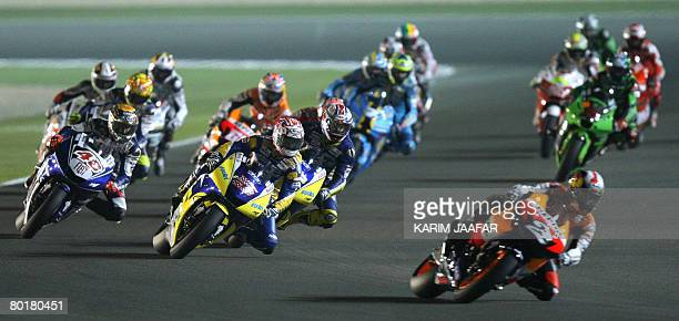 A general view of the MotoGP event held under lights at the Losail International Circuit in Doha on March 9 2008 Australian Ducati rider Casey Stoner...