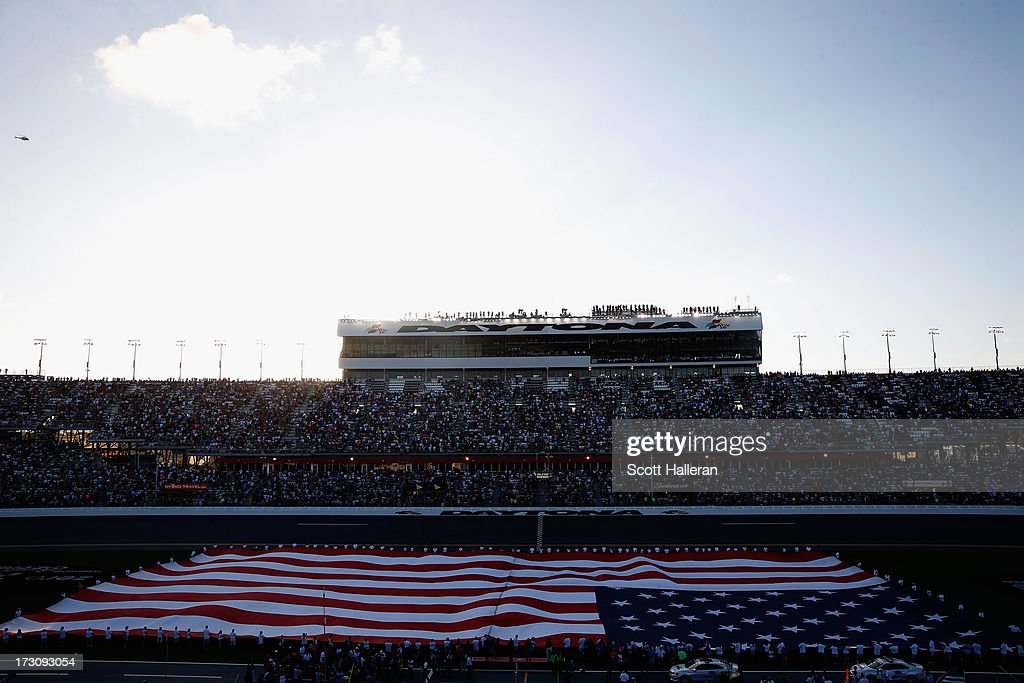 A general view of the national anthem before the NASCAR Sprint Cup Series Coke Zero 400 at Daytona International Speedway on July 6, 2013 in Daytona Beach, Florida.