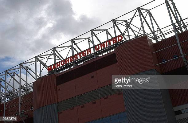 A general view of the neon Manchester United sign on top of the North Stand at Old Trafford in silhouette on October 4 2003 in Manchester England