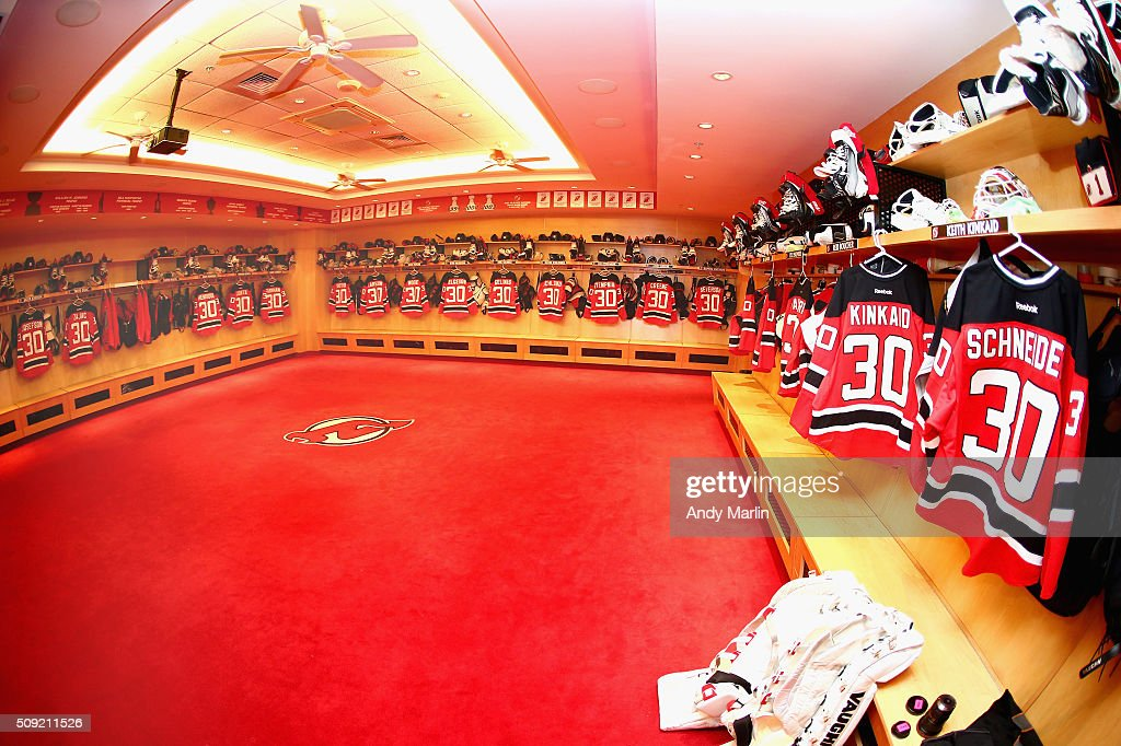 A general view of the New Jersey Devils locker room displaying the Devils' jerseys with the #30 in honor of the retirment of Brodeur's jersey prior to the game against the Edmonton Oilers at the Prudential Center on February 9, 2016 in Newark, New Jersey.
