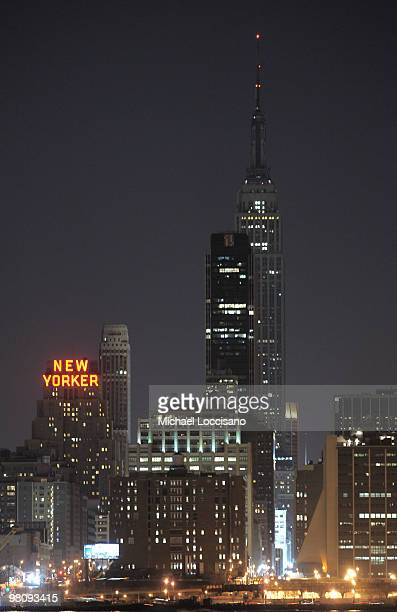 General view of the New York City Skyline is seen as the Empire State Building and Chrysler Building turn off their tower lights for one hour on...