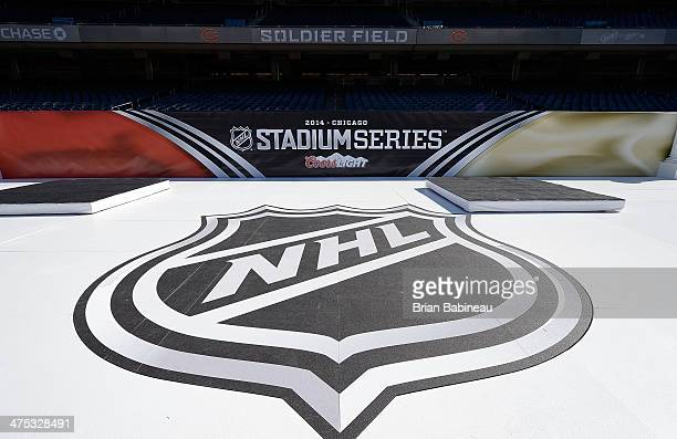 A general view of the NHL logo is seen on the field during the 2014 NHL Stadium Series rink build out on February 27 2014 in Chicago Illinois