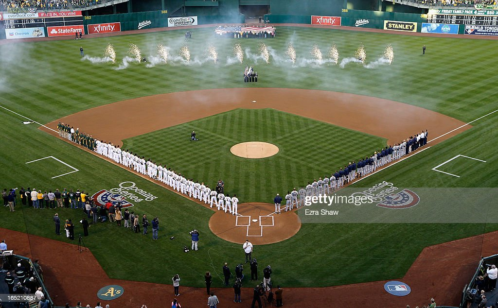 General view of the Oakland Athletics and the Seattle Mariners stand for the signing of the National Anthem during Opening Day at O.co Coliseum on April 1, 2013 in Oakland, California.