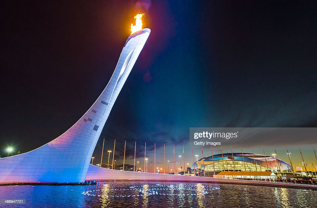 A general view of the Olympic Cauldron and flame with the Olympic Rings and the Bolshoy Ice Dome in the distance at sunset during day 5 of the Sochi...