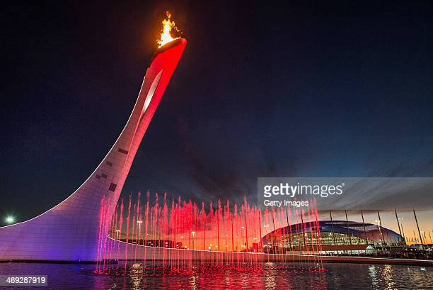 A general view of the Olympic Cauldron and flame with the Olympic Rings water fountain and the Bolshoy Ice Dome in the distance at sunset during day...