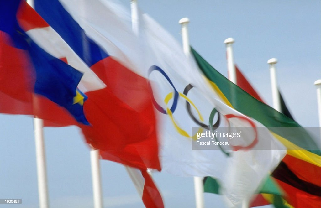 A general view of the Olympic Flag bordered by other national flags during the 1992 Olympic Games in Barcelona Spain